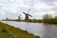 Traditional dutch windmill near the canal. Netherlands Stock Image