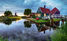 Traditional dutch windmill near the canal. Netherlands, Landcape Royalty Free Stock Photo
