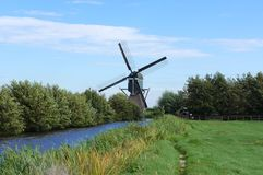 Reeuwijkse Plassen nature area, the Netherlands. A traditional Dutch windmill in the Reeuwijkse Plassen nature area, South Holland province, the Netherlands Royalty Free Stock Photography