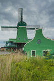 Traditional Dutch windmill in Zaanse Schans (Netherlands). Royalty Free Stock Images