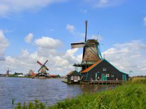 Traditional Dutch Windmills. Along the water at Zaase Schans, near Amsterdam, Holland Stock Photography