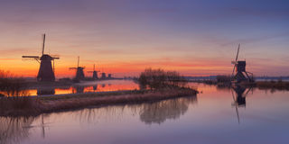 Free Traditional Dutch Windmills At Sunrise At The Kinderdijk Royalty Free Stock Photo - 57892375