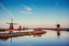 Traditional Dutch windmills from the channel Rotterdam. Holland Royalty Free Stock Photo