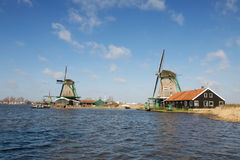 Traditional Dutch windmills on the river bank, the Netherlands Royalty Free Stock Photos