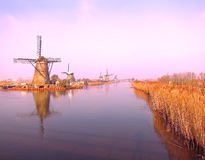 Traditional Dutch windmills in winter in Netherlands royalty free stock images