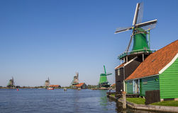 Traditional dutch windmills at the Zaan river Royalty Free Stock Images