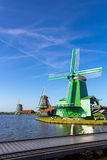 Traditional Dutch windmills in Zaanse Schans, Amsterdam, Netherlands. A traditional dutch windmill Netherlands Royalty Free Stock Photos