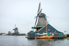 Traditional dutch windmills. In Zaanse Schans village, Holland Royalty Free Stock Images