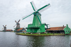 Traditional dutch windmills. In Zaanse Schans village, Holland Royalty Free Stock Image