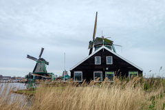 Traditional dutch windmills. In Zaanse Schans village, Holland Stock Photos