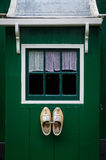 Traditional dutch window and wooden shoes. In Zaanse Schans village, Holland Royalty Free Stock Images