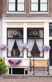 Traditional dutch windows with flowers Royalty Free Stock Image