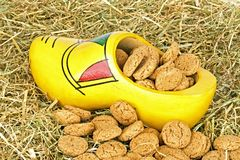 Traditional dutch wooden clog with  gingernuts in straw Stock Image