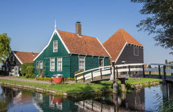 Traditional dutch wooden house and white bridge in Zaanse Schans Stock Photography