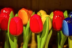 Traditional Dutch Wooden painted colorful tulips in souvenir shop stock image