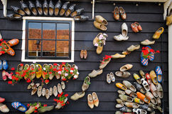 Traditional dutch wooden shoes hanging on a wall as decoration Royalty Free Stock Image