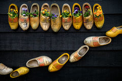 Traditional dutch wooden shoes. Mounted on a wall Stock Photo