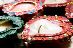 Traditional earthenware wax lamp (diya). Tradional earthenware lamp (diya) decorated with paint and gems. These are traditionally lit on diwali the festival of Stock Image