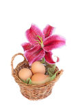 Traditional easter basket with lily flower stock photo