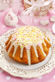 Traditional easter cake decorated with icing and colorful sprink Stock Images