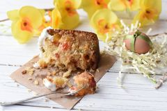 A traditional Easter cake and festive decoration on a white wooden surface Royalty Free Stock Image