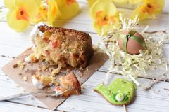 A traditional Easter cake and festive decoration on a white wooden surface Stock Image
