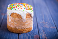 Traditional easter cake kulich Ukrainian Russian on wooden background Royalty Free Stock Photo