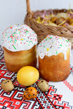 Traditional easter cake kulich Ukrainian style with colored eggs on painted towel. Homemade traditional easter cake kulich Ukrainian style with colored eggs on Royalty Free Stock Images