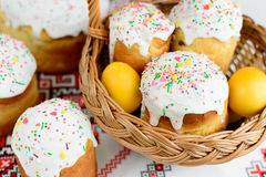 Traditional easter cake kulich Ukrainian style with colored eggs on painted towel Stock Image