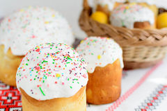 Traditional easter cake kulich Ukrainian style with colored eggs on painted towel Royalty Free Stock Images