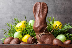 Traditional Easter chocolate bunny and eggs inside a wooden crate royalty free stock photo