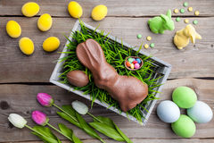 Traditional Easter decoration background with flowers, bunnies and eggs Stock Photos