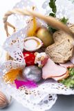 Easter basket with colorful Easter eggs. Tradition of Easter. stock image