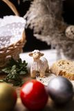 Tradition of Easter, colorful eggs, lamb, wicker basket. stock photo