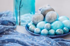 Traditional Easter dyed eggs and willow branches Easter celebration. royalty free stock photo