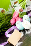 Traditional easter egg decoration with tulips and ribbo Stock Images