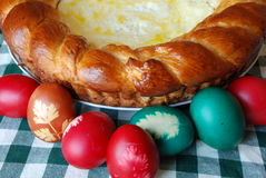 Traditional Easter eggs and cake. Colorful Easter eggs and traditional romanian cake for Easter Stock Image