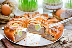 Traditional Easter food recipe meatloaf stuffed with eggs. Baked in dough Royalty Free Stock Images