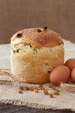 Traditional easter holiday cake sweet bread also called kulich with raisins and eggs on vintage textile Stock Photo