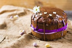 Traditional Easter panettone or russian kulich. On wooden background with flower Stock Photo