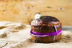 Traditional Easter panettone or russian kulich. On wooden background with flower Royalty Free Stock Photography
