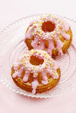 Traditional easter yeast cake covered with pink icing Stock Images