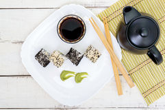 Traditional eastern dish with salmon, shrimp - sushi rolls on a white plate. Royalty Free Stock Photo