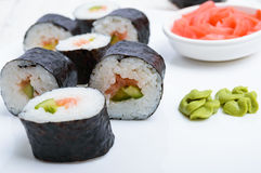 Traditional eastern dish with salmon sushi rolls on a white plate. Stock Photography