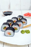 Traditional eastern dish with salmon sushi rolls on a white plate. Stock Image