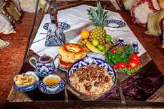 Traditional eastern dishes. On a plate on the table Royalty Free Stock Image
