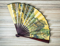 Traditional eastern fan with painted artistic pattern Royalty Free Stock Photo