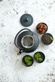Traditional eastern metal teapot and iron cups stock image