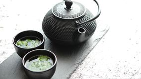 Traditional eastern metal teapot and iron cups stock footage