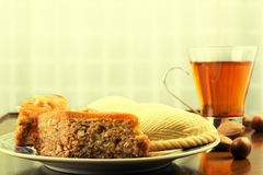 Traditional Eastern sweet pastry shekerbura and baklava, cup of Royalty Free Stock Images